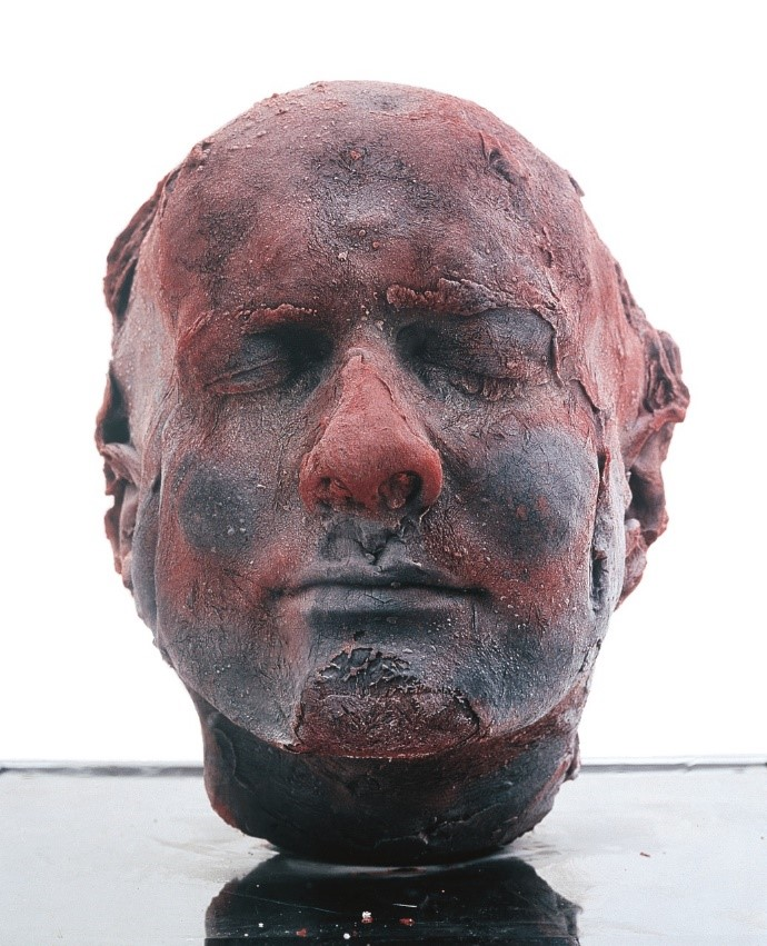 """Self 1991"". Quinn, Marc. 1991. Blood (artist's), stainless steel, Perspex and refrigeration equipment. 208h x 63w x 63d cm. From the artist's website, not from the Met Breuer website. Copyright Marc Quinn."