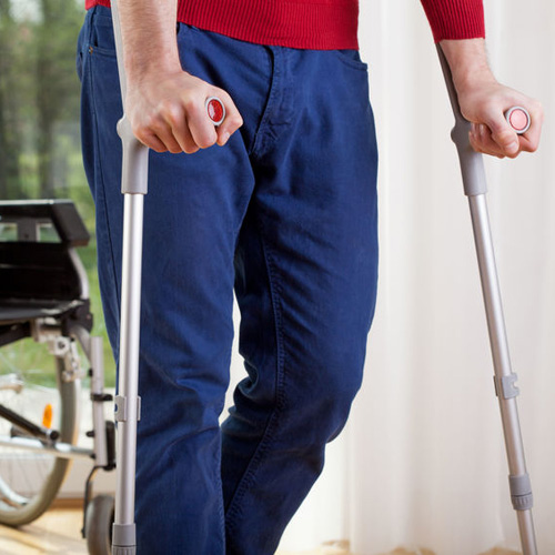 28646617_s-horizontal-view-of-a-disabled-man-on-crutches_500x500.jpg