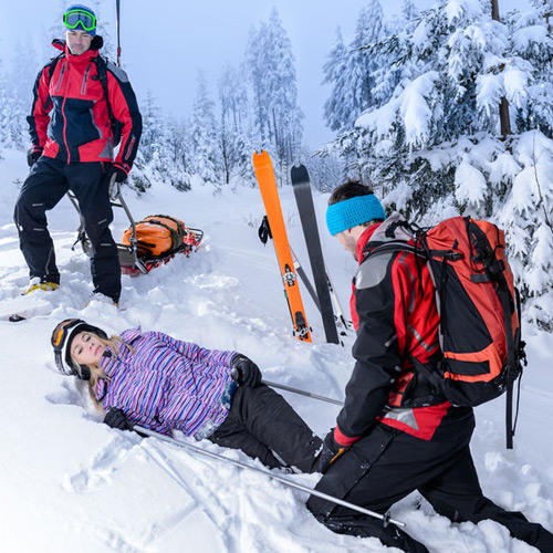 25109380_s-escue-ski-patrol-help-injured-woman-skier-lying-in-snow_500x500.jpg