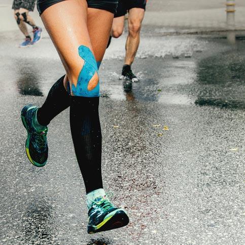 taped marathon knee injury