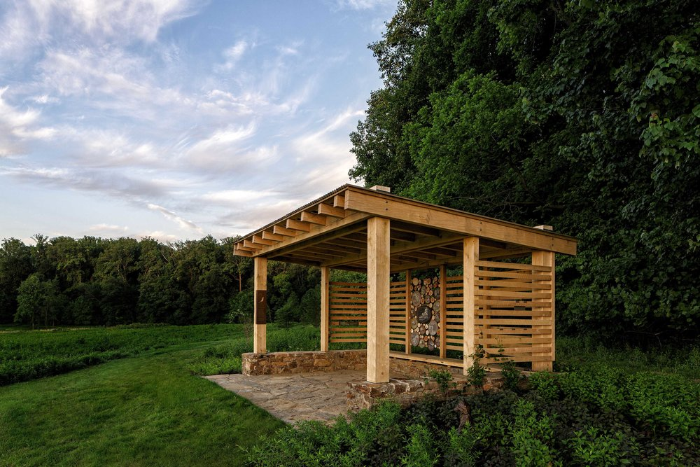Several rustic pavilions, featuring local building materials and methods, highlight great views. Seated amidst enhanced plantings, the guests' attention is directed toward the dynamics of the woodland edge, the birds that inhabit the meadow, or the pollinators that buzz around them.