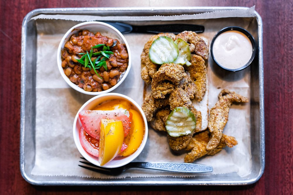 Styrofoam plates may have been traded in for trendier metal trays, but the plastic silverware reminds you that this is pure, classic southern food.