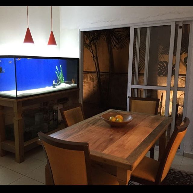 Check out this beautiful table and stand for the fish tank made from reclaimed peroba rosa. The legs are made from reclaimed ipe!