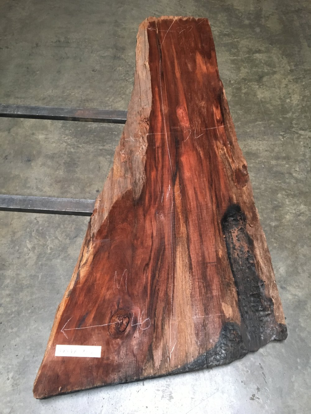 old growth redwood slab from from a 1200 year old log! It has been air drying since the 40's when it was originally dropped.