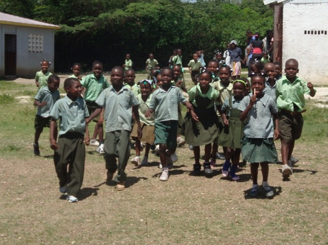 School children in our newest site run to greet GOALS and Waves 4 Water