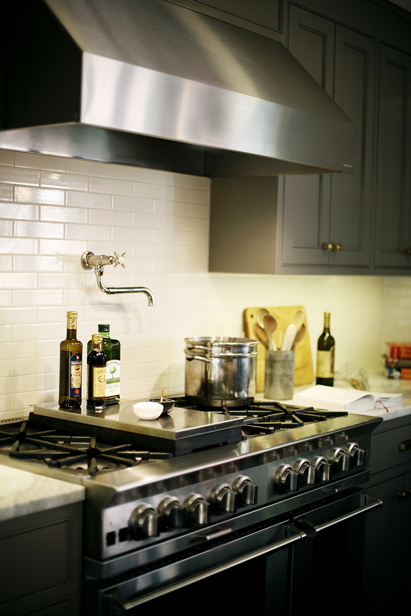 MODERN AMENITIES - The kitchen is equipped with all the necessary modern amenities, including this stainless 6-burner range and stainless hood.