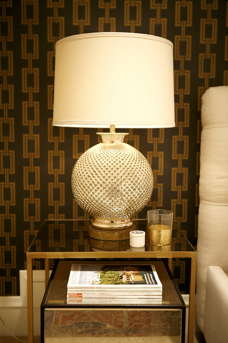AN EXTENSION OF THE HOME - The owner wanted to the basement to feel like an extension of their home. The quality and detail of each and every element are carefully chosen to reflect the high-end design of the upper floors, including this tactile Phillip Jeffries wall covering in the guest room.
