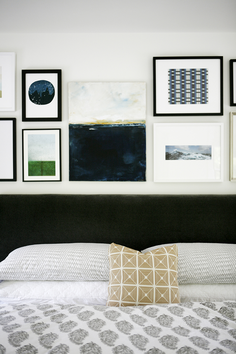 COLLECTED OVER TIME - A humble art collection combines to create a unique and calming accent wall in the master bedroom.