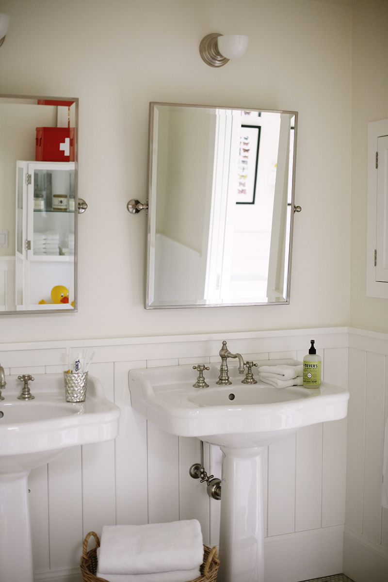 GIRLS ONLY - A set of pedestal sinks, mirrors, and medicine cabinets allow for a less chaotic morning, while the tile lined tub becomes the quintessential setting for those long bath times.