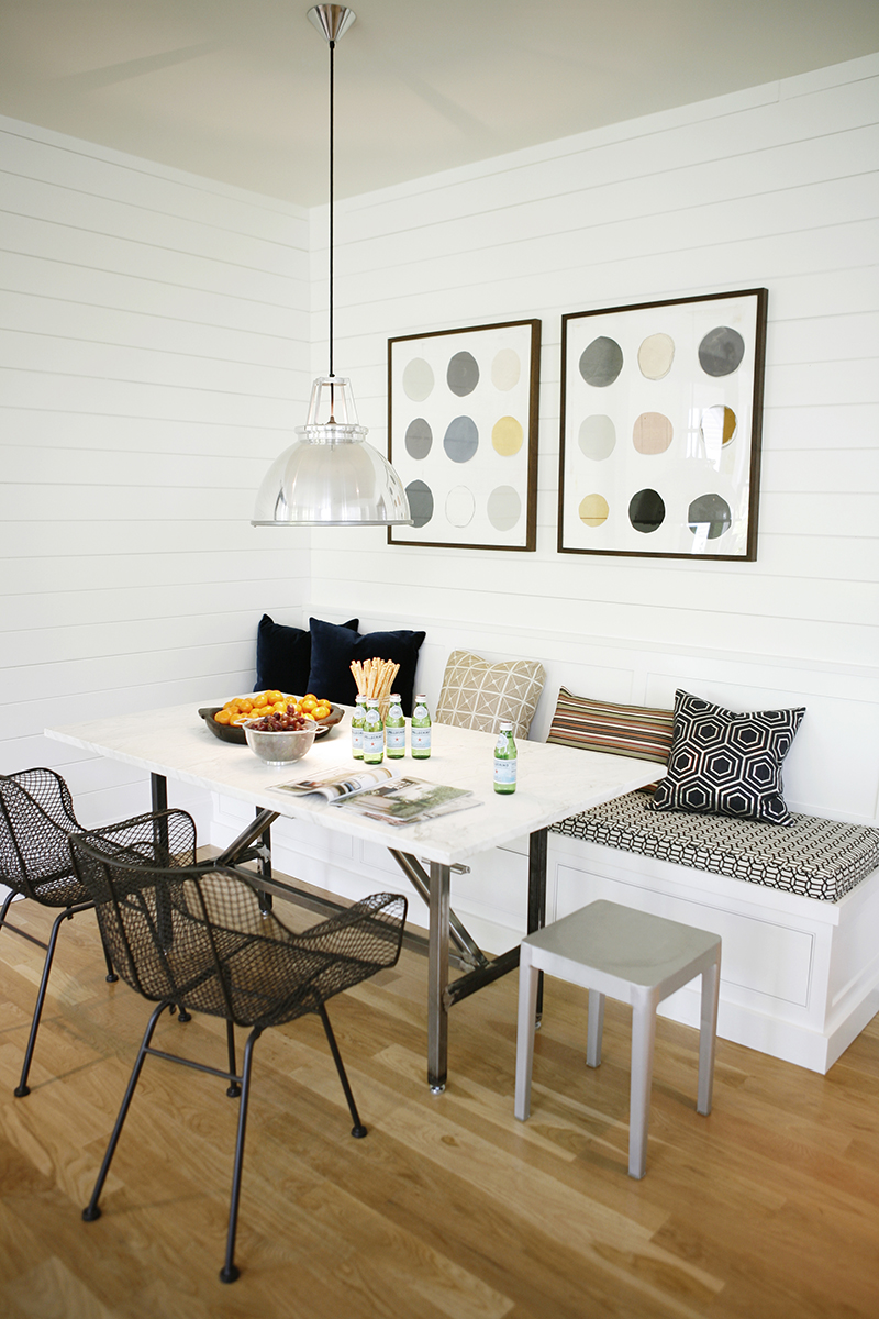 WHITE ON WHITE - White painted wood paneling adds texture to the walls throughout the home, and provide the perfect backdrop for artwork, fabric, and furnishings to take the lead.