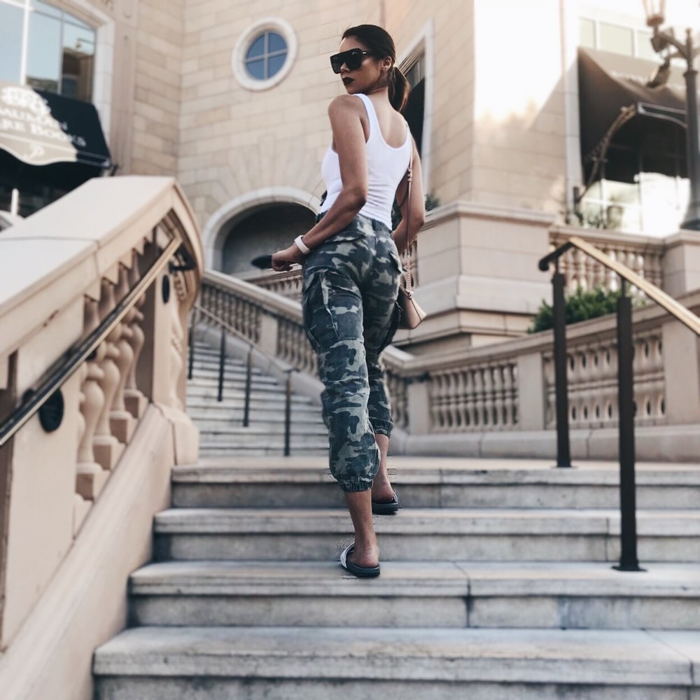 PRODUCTS PICTURED:  ELAINA BODYSUIT - WHITE  CADET KIM OVERSIZED CAMO PANTS
