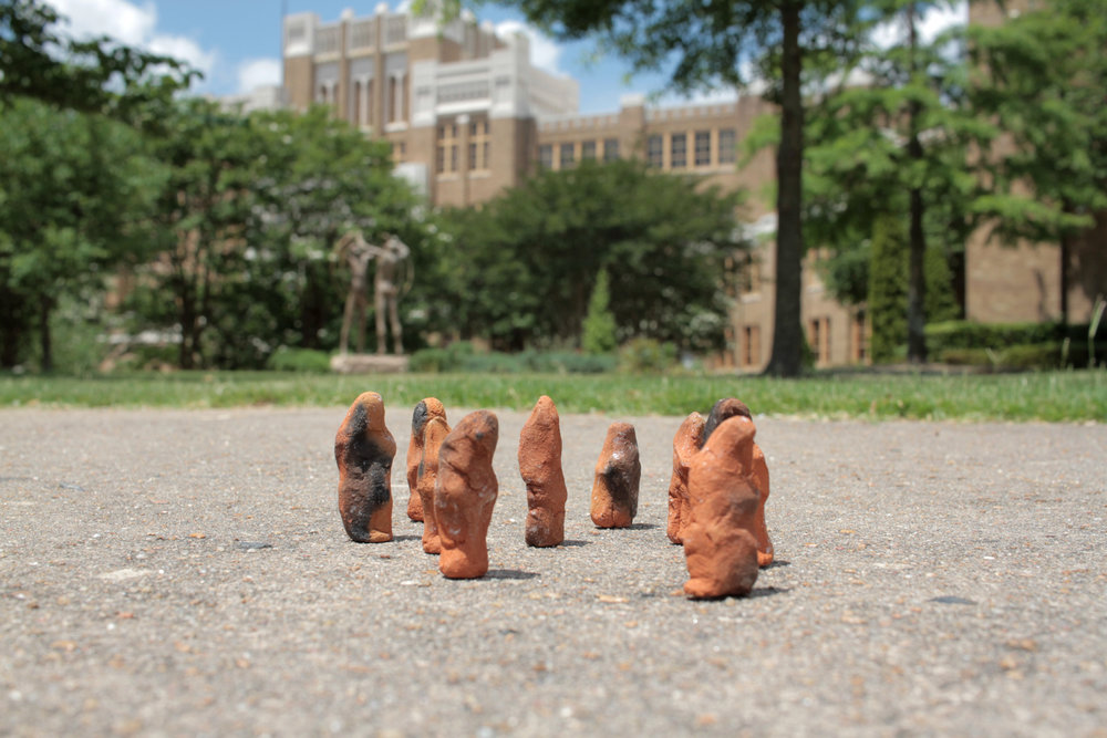Clay from Central High School in Little Rock (sidewalk repair) , formed and fired. Photographed in front of Central.
