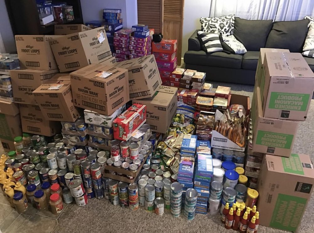 A progress picture of the food drive collection. Items were donated as well as purchased with funds raised.