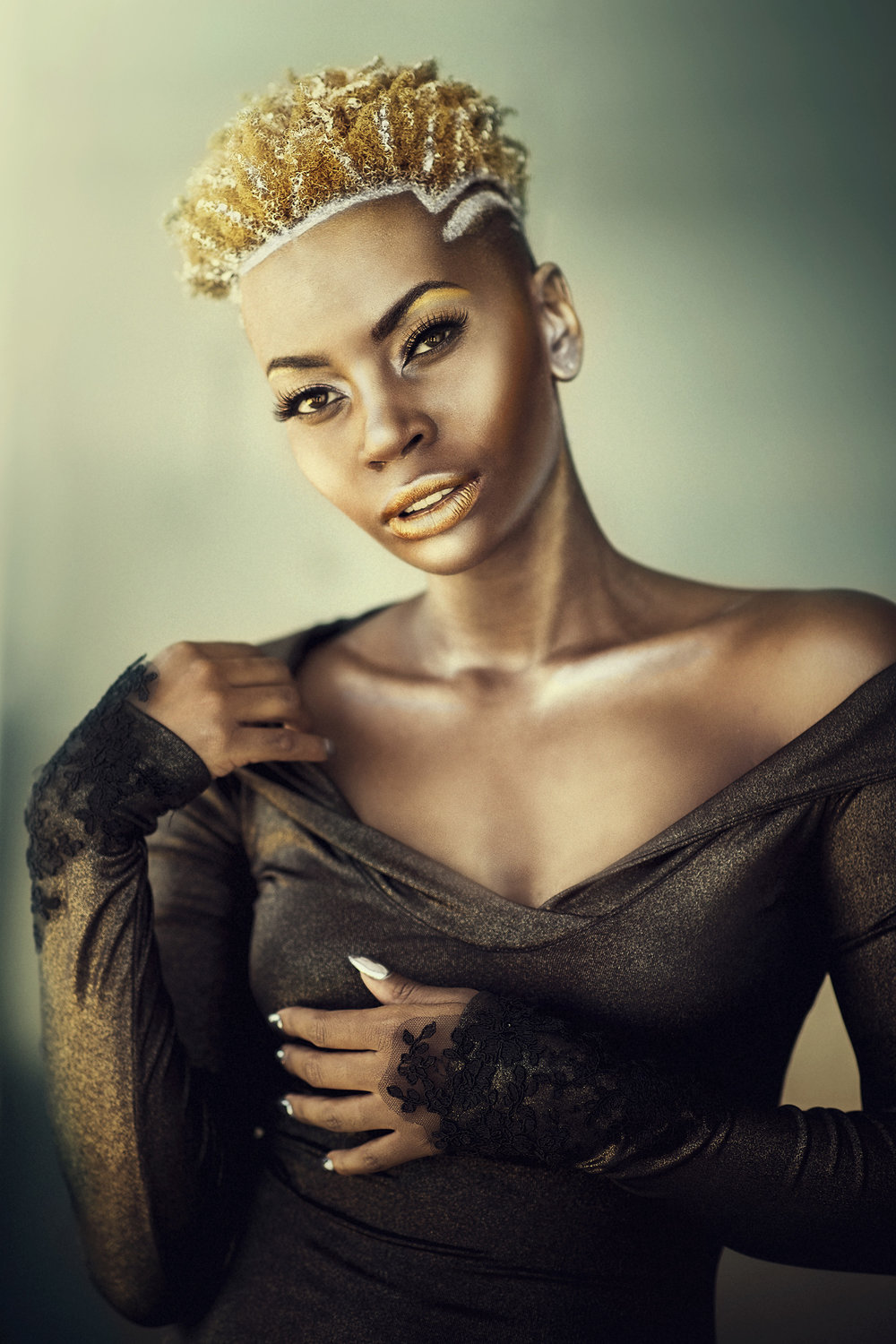 black fashion model in gold.jpg