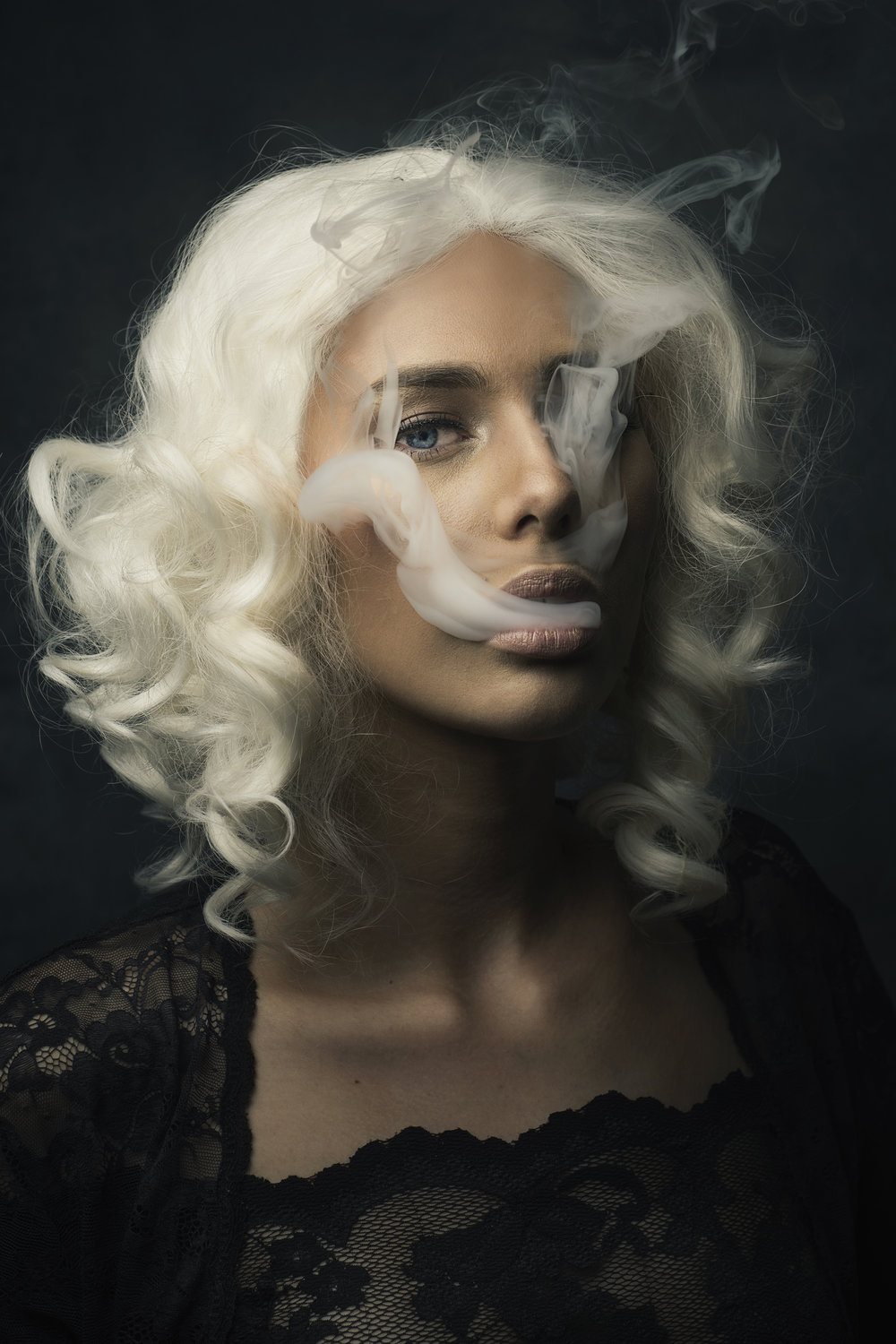 smoking girl vaping in a wig.jpg