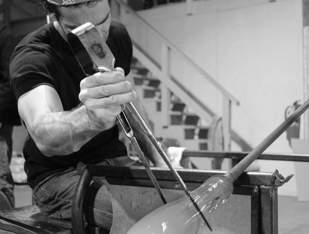Joe Corcoran blowing glass at DC Glassworks.