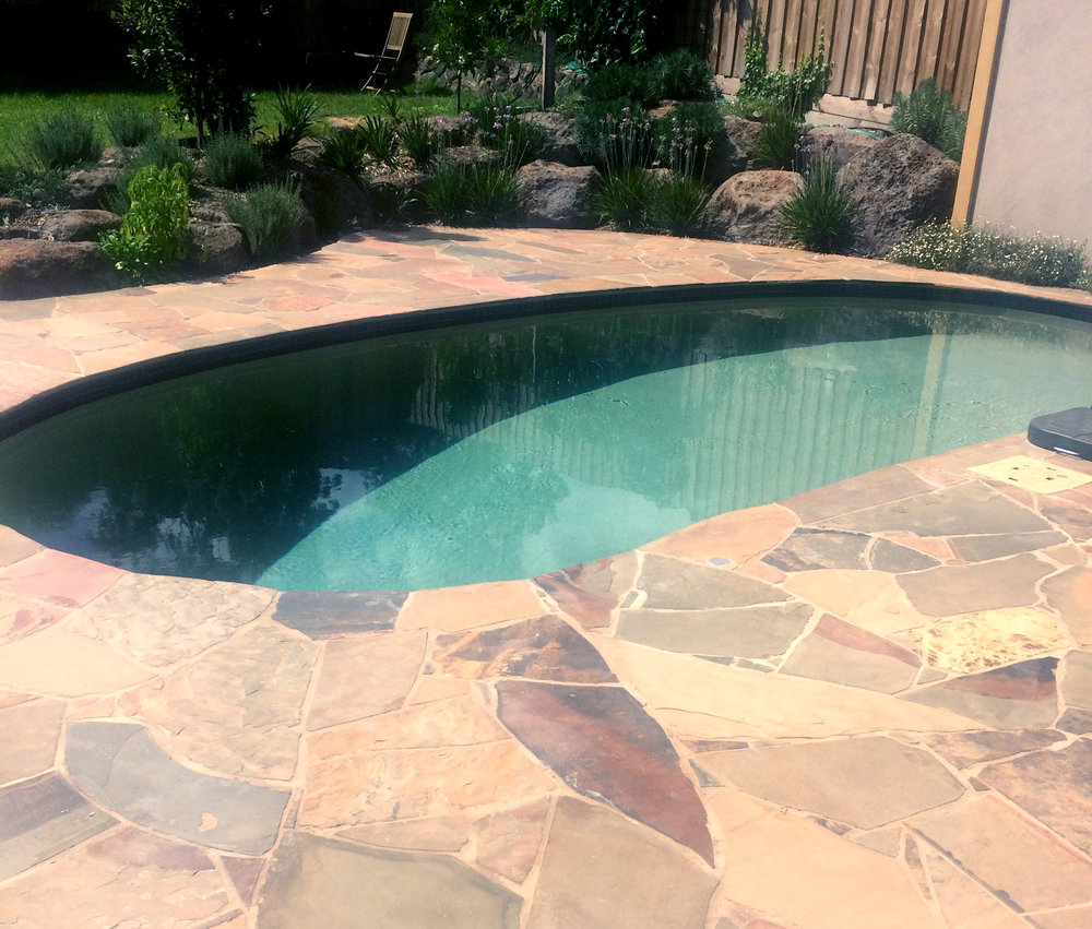 Crazy Paving in Kruger Slate around Pool as Coping