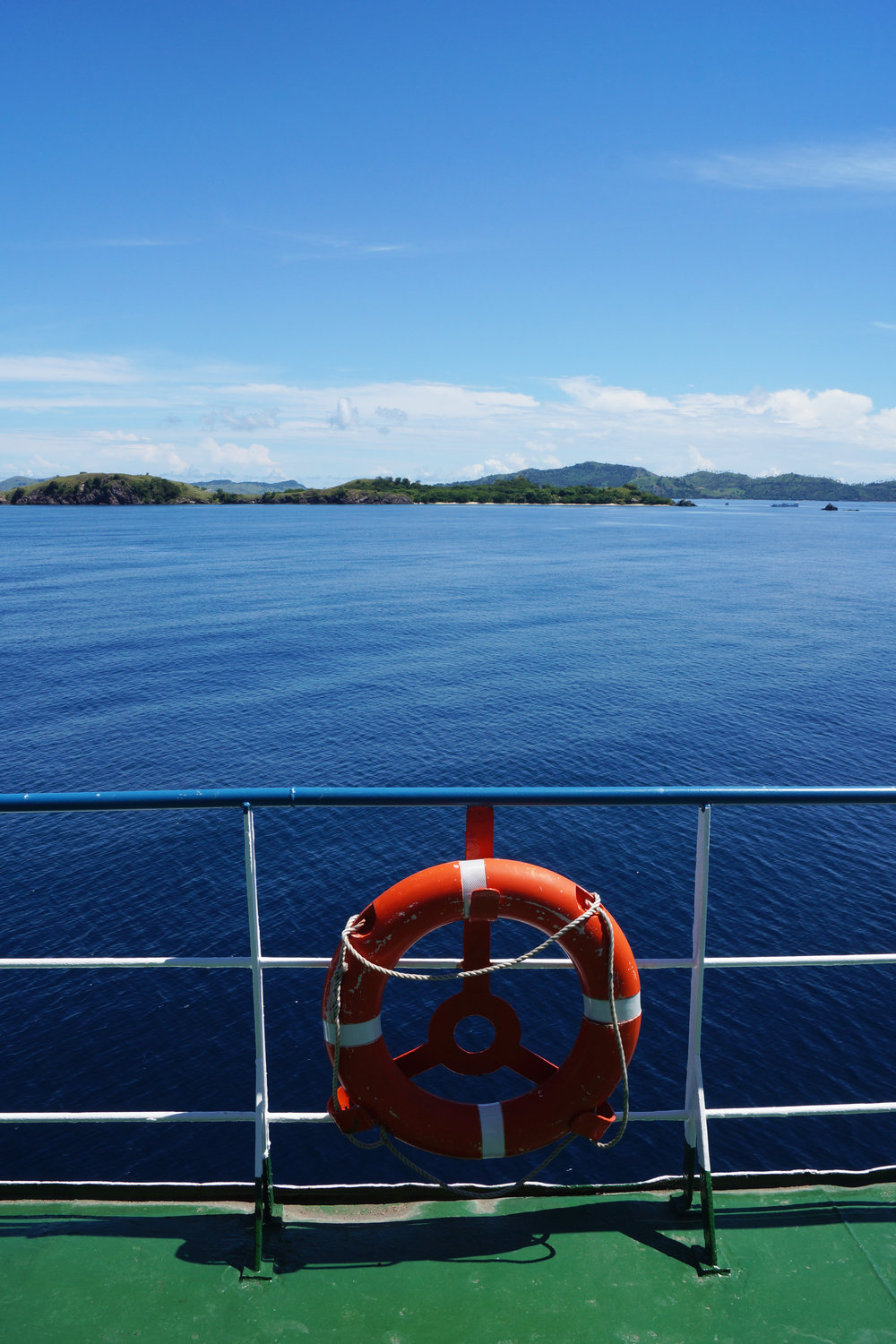 Looking back towards Flores from the sunny upper-deck.