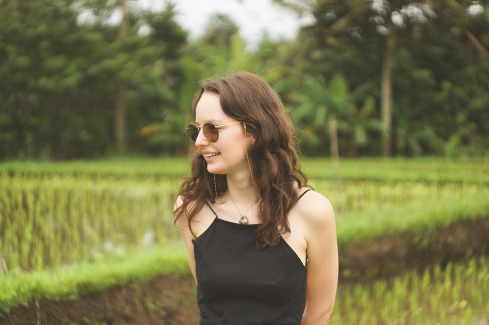 Emily wandering rice fields outside Ubud, Bali.