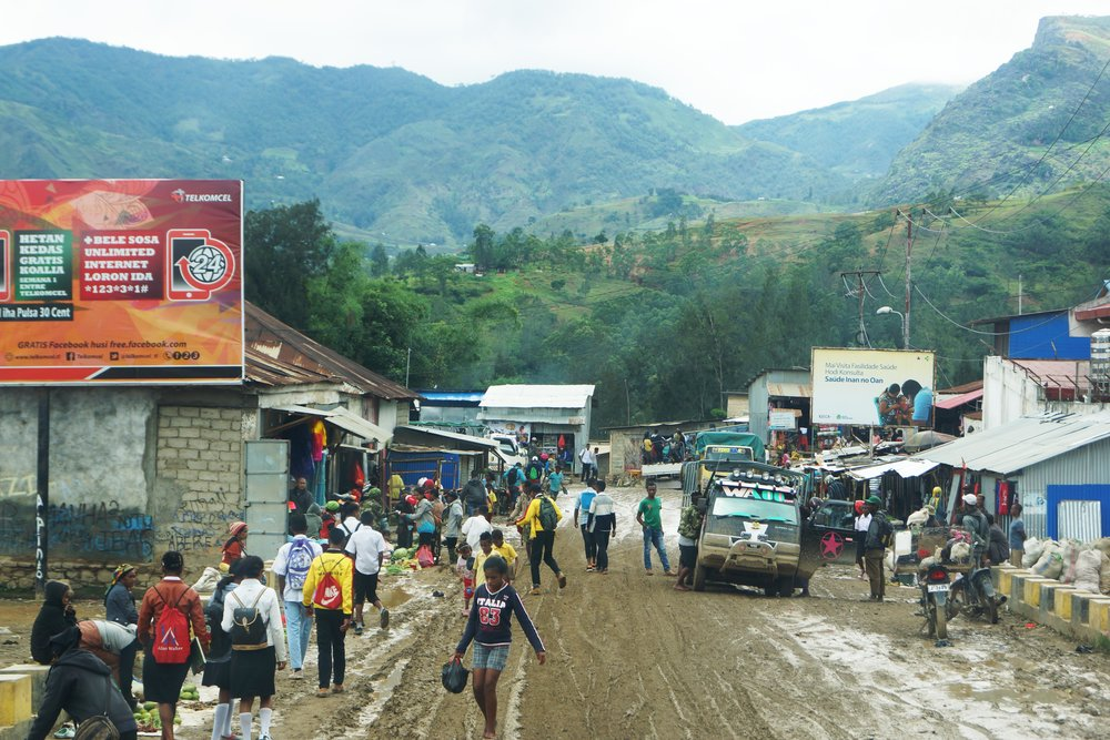 The muddy mainstreet of Maubisse, a hill-town in inland Timor Leste on the road to Ramelau.