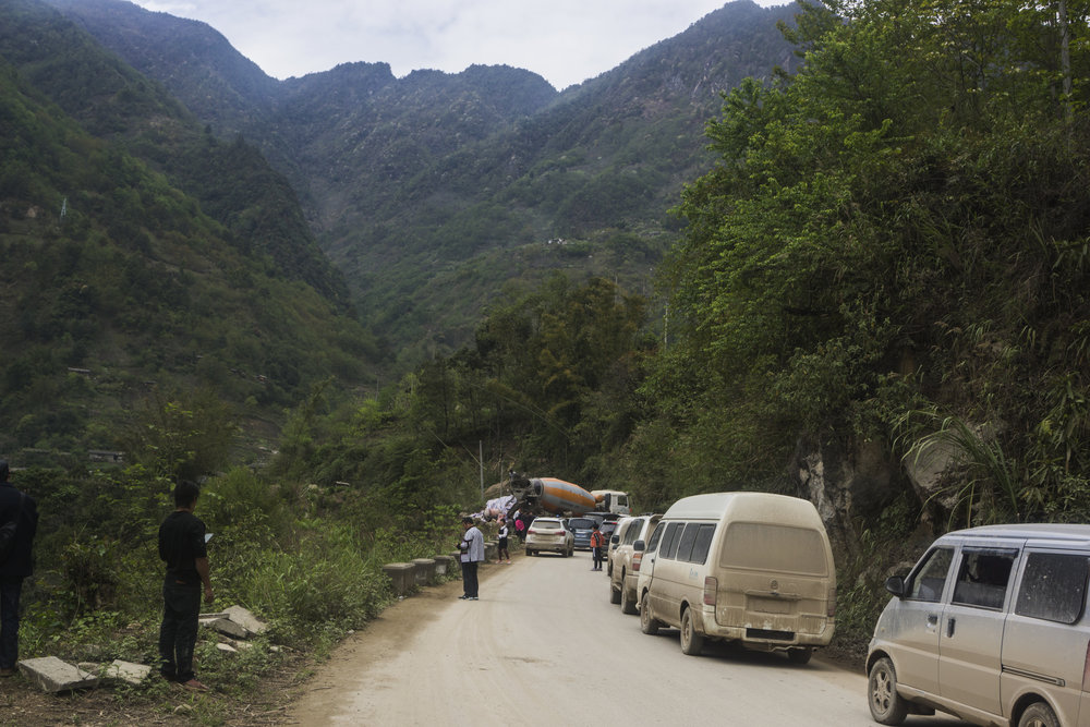 Traffic jam on a paved section of the road between Fugong and Gongshan.