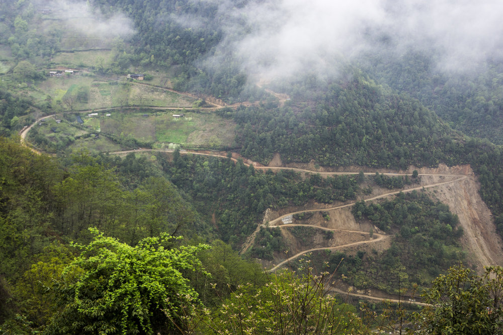 A new road being carved into the hillsides west of Bingzhongluo.