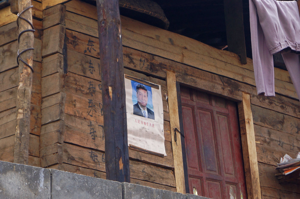 A calendar with the face of Chinese President, Xi Jinping, on a small home outside Bingzhongluo.