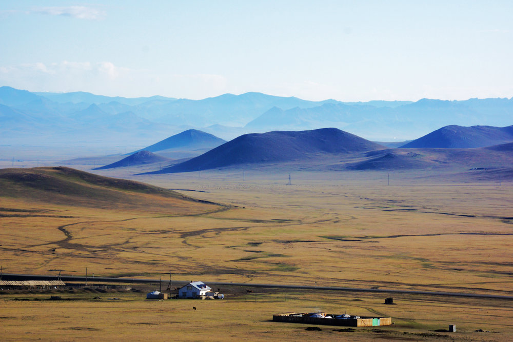 Mongolia in the early morning light. Taken from the train just before Ulaanbaatar.