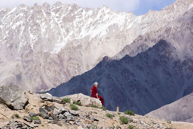 A Pamiri woman rests and takes in the view. Zong Village, Tajikistan.
