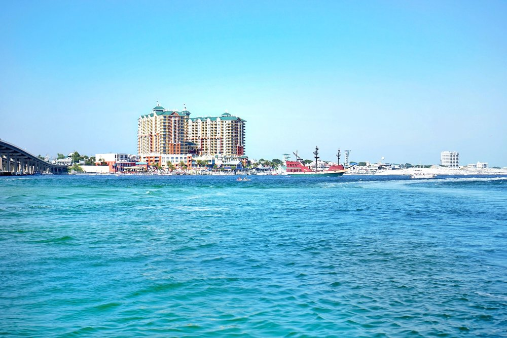 The  Emerald Grande  sits at the edge of the Destin harbor on the way to crab island.