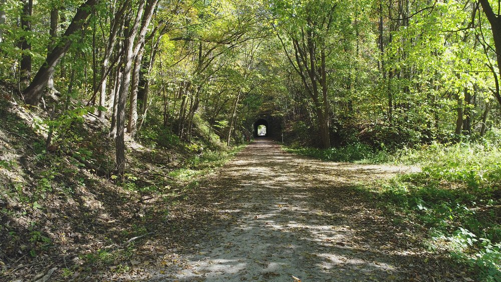 Looking east on Katy Trail. 1892 trail tunnel in background to historic Downtown Rocheport.