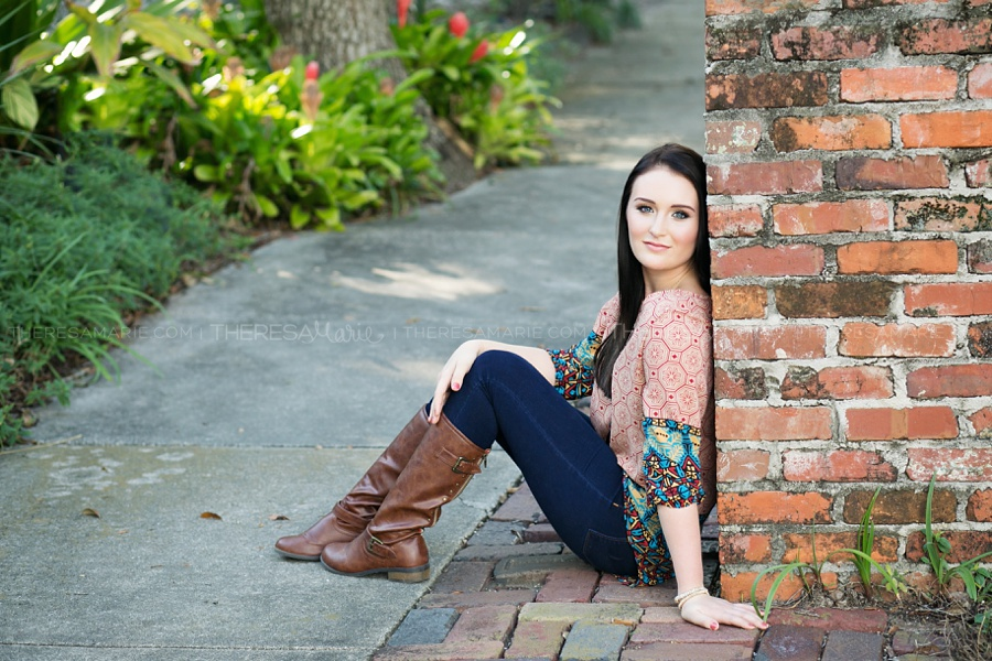 Urban senior photo in downtown Tampa with brick wall and pathway