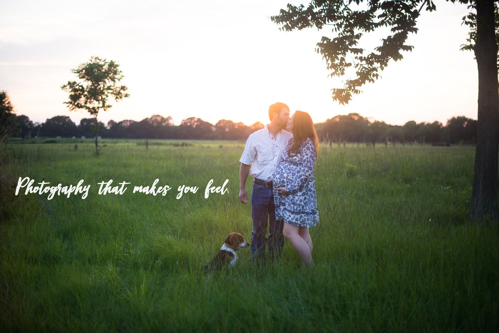 joyful jane photography Louisiana lifestyle family photographer expecting couple standing in a field in their backyard at sunset with pet dog