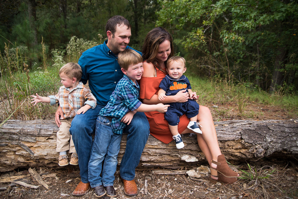 family pictures, family sitting on a log with 3 boys