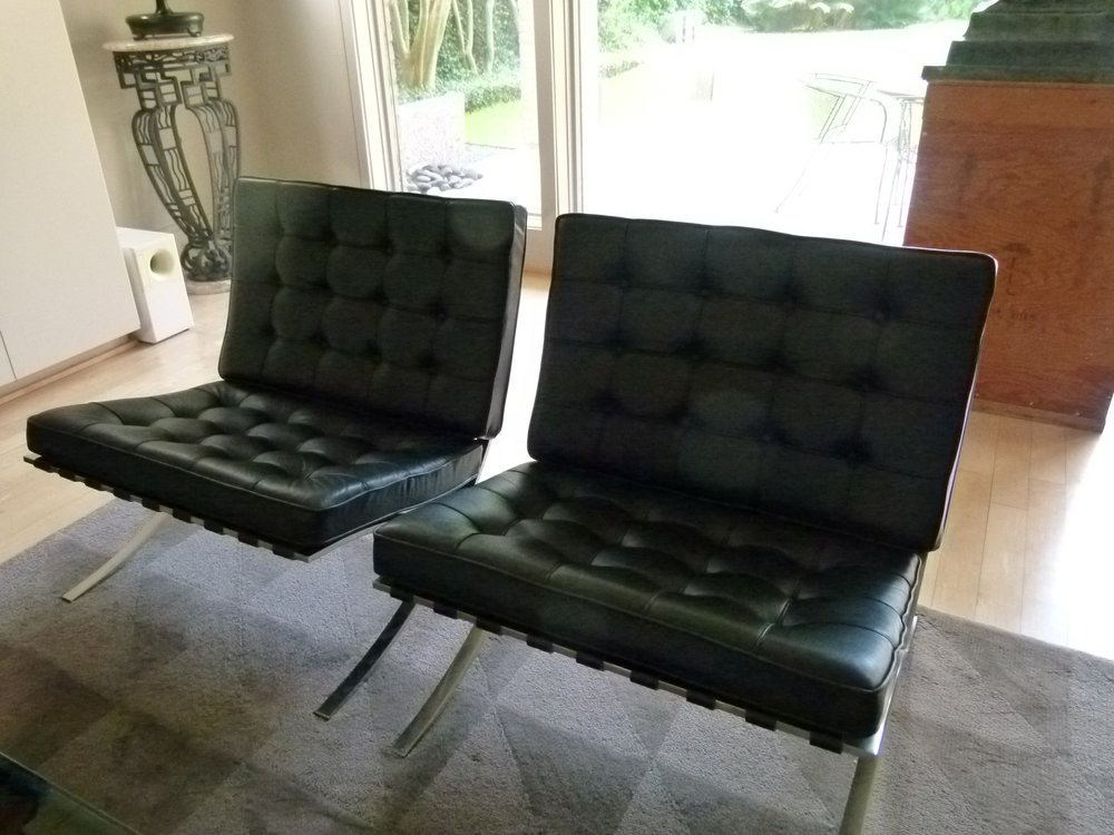 Pair of black leather Barcelona chairs