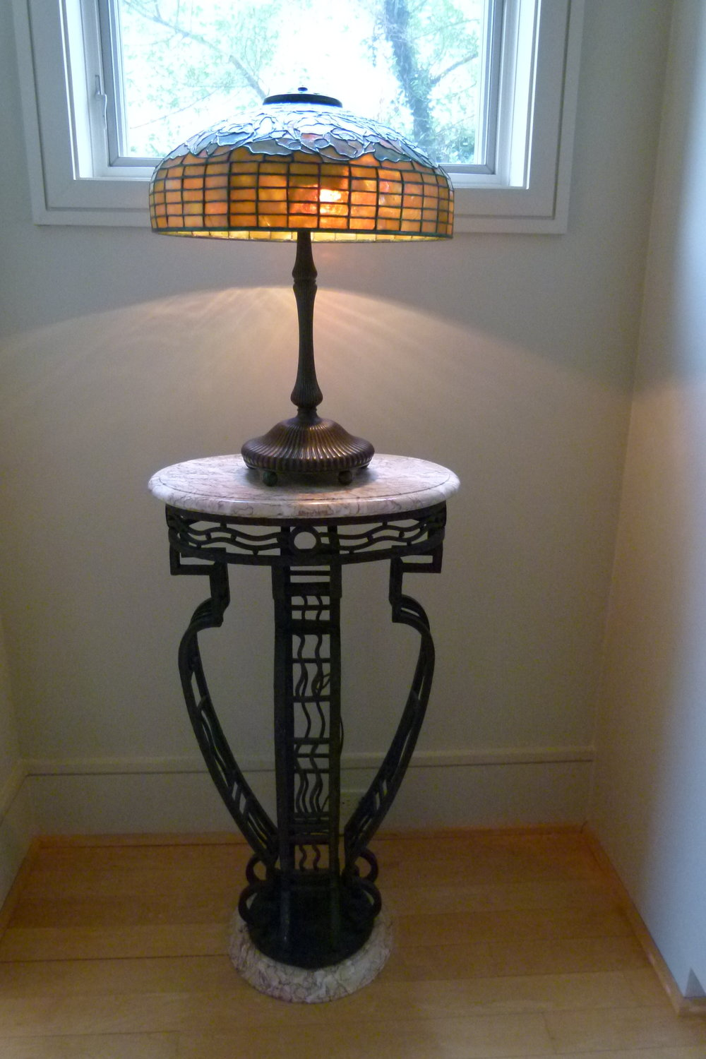 Pair of cast iron tables with marble tops