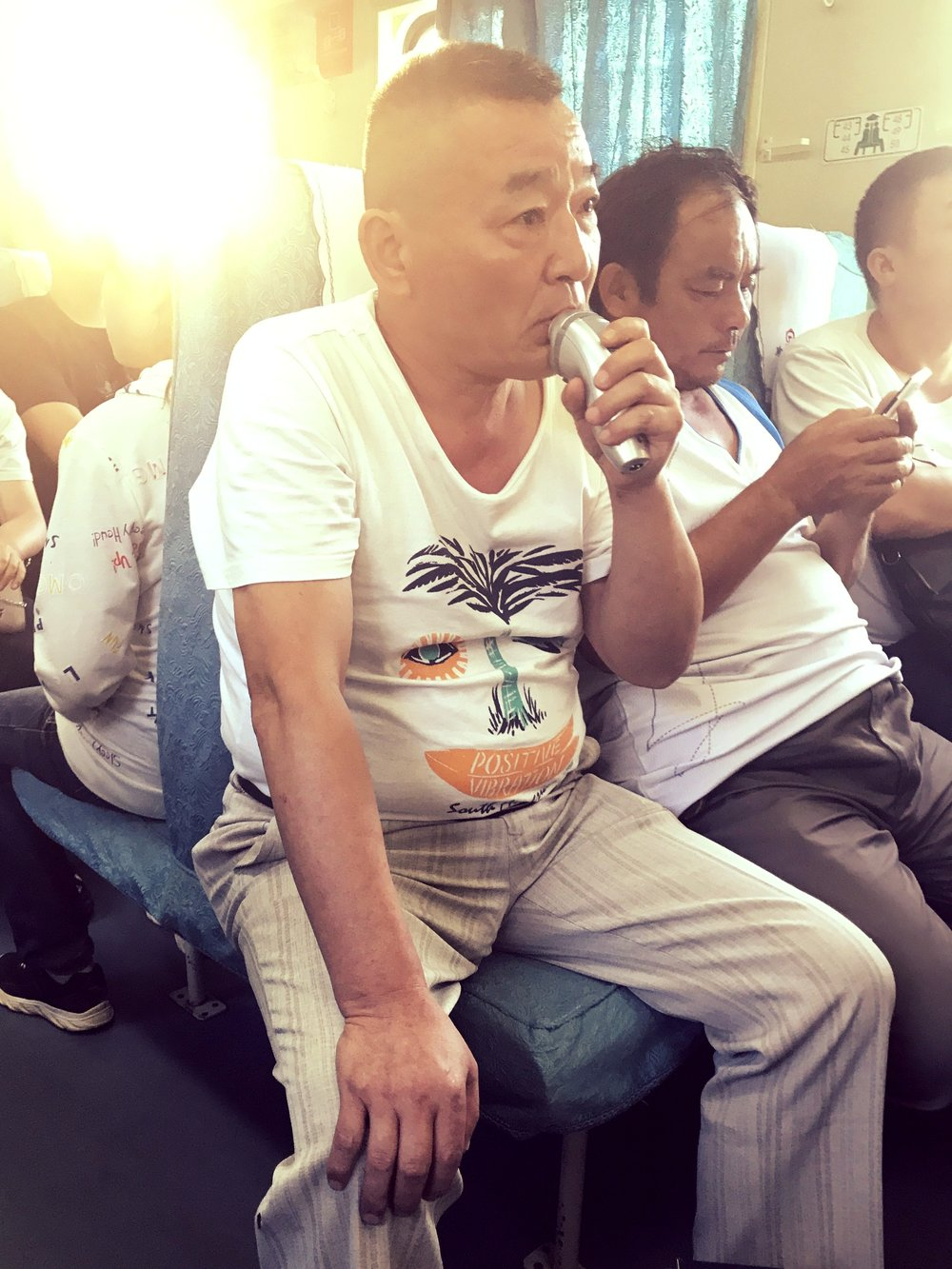 CHINESE MAN SHAVING ON THE TRAIN