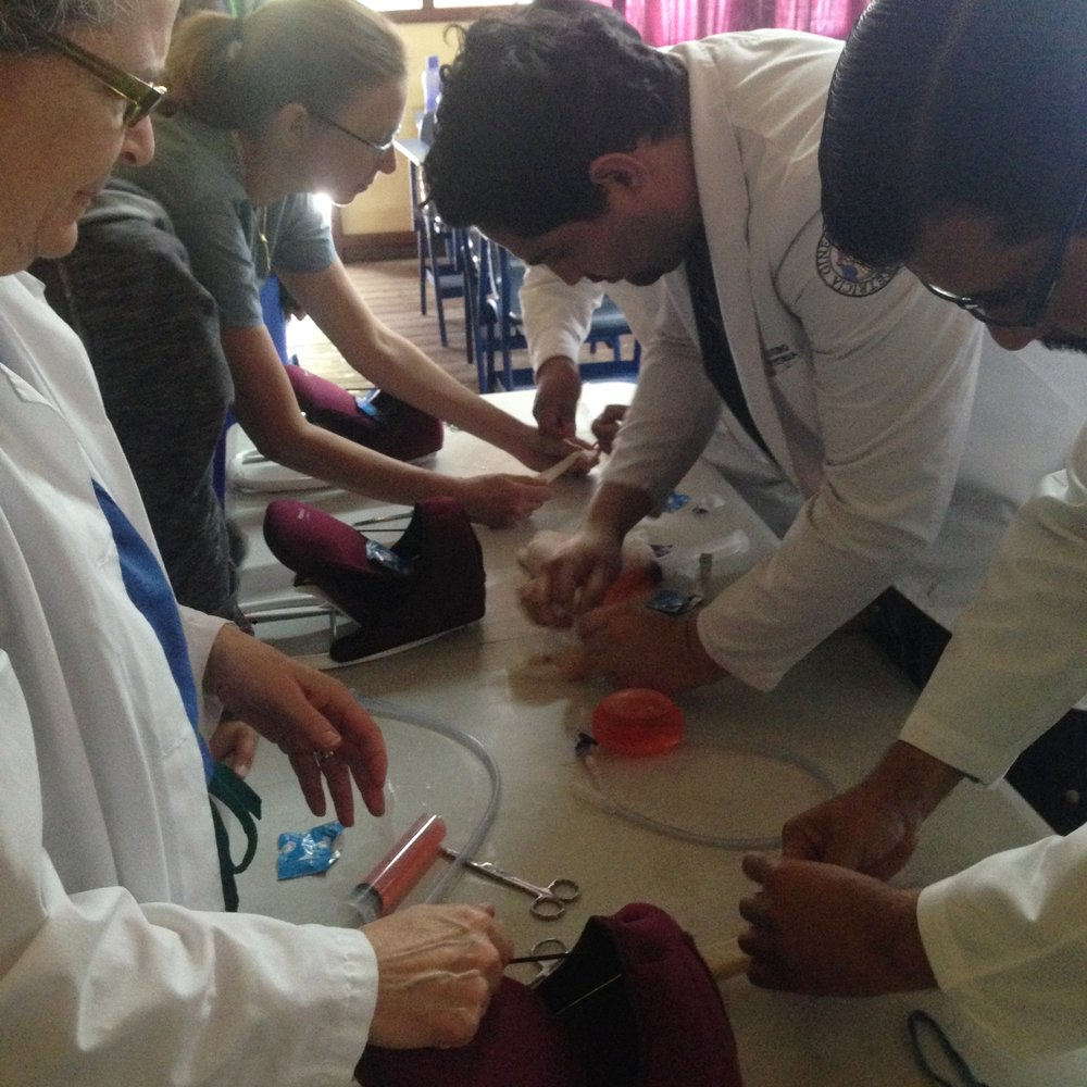 Medical students guided by Dr. Kay Daniels and Dr. Antonia Nicosia practice making and inserting balloon tamponades in Guatemala.
