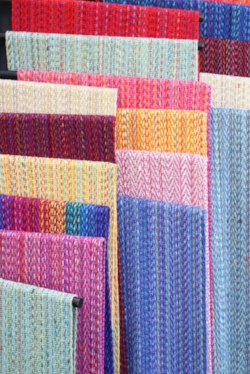Colorful Handwoven scarves at an outdoor art festival