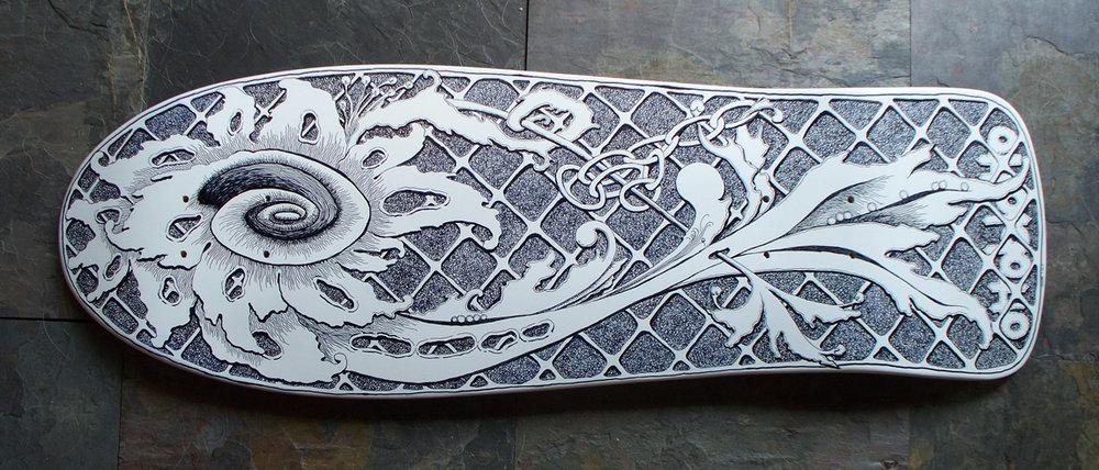 Skateboard deck customized with a sharpie