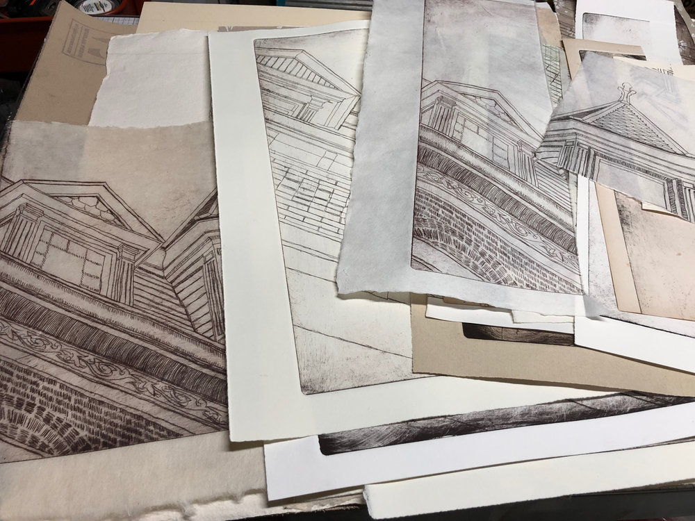 Piles of partial drypoint image impressions, ready for collaging