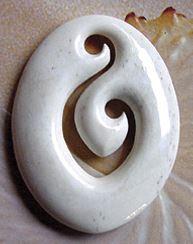 A double koru bone carving