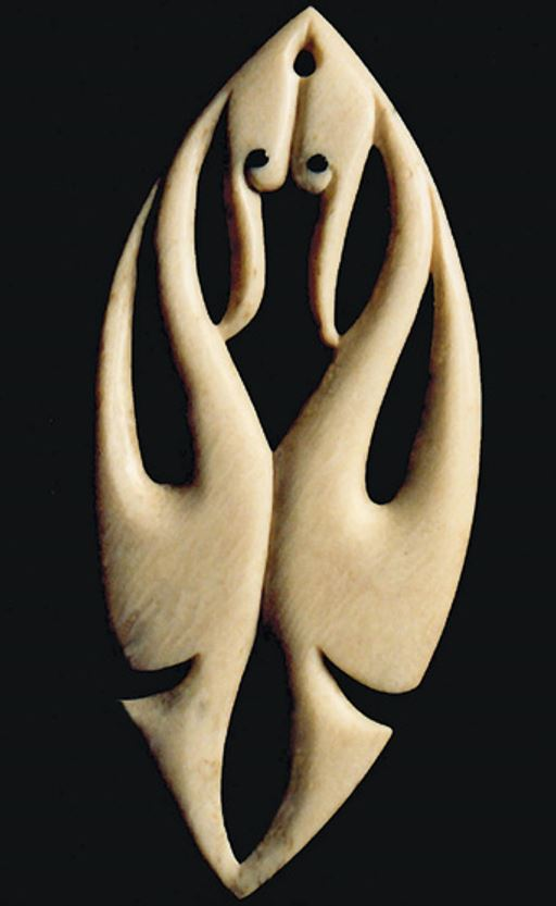 Carving of a pair of kōtuku greeting each other