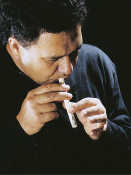 The late Dr Hirini Melbourne playing a bone koauau