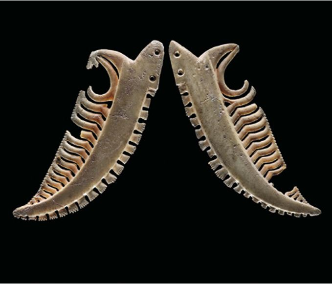A pair of early whale tooth carvings from the collection of Te Papa Tongarewa