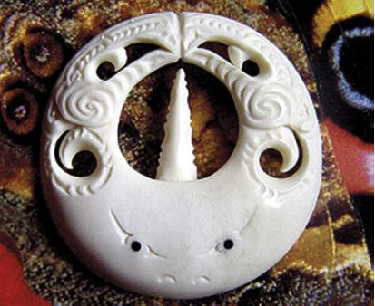 Stingray carving with manaia faces on its wings