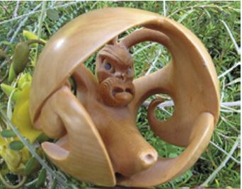 Boxwood carving of a kahukura in the form of a Japanese netsuke