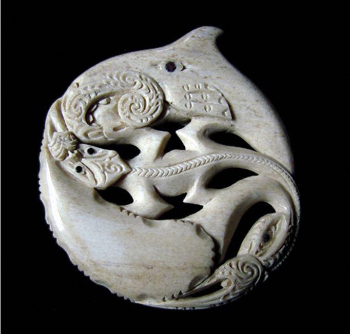 A carving depicting creatures associated with Rangitoto ki te Tonga (D'urville Island)