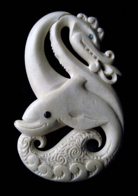 One of a pair of carvings which blend the dual ancestry of a local family, whose Māori traditions are linked to a guardian dolphin and whose Welsh traditions are associated with a dragon.