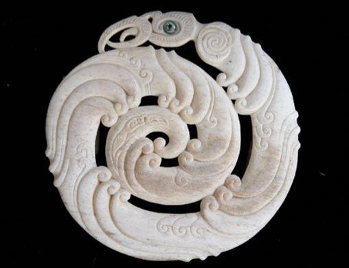 Whalebone carving by Owen Mapp representing Ngāke emerging from the ocean